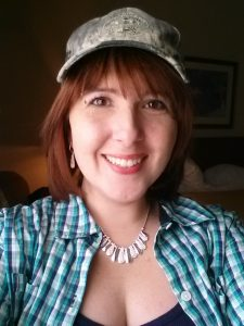 Tiff_plaid We would like to introduce you to June 2014World Wide College of Auctioneering Graduate Tiffany Earnest